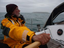 Jacques Poumet at Avannaq's helm while landing on the Head of Kinsale.