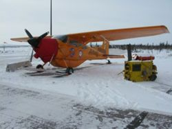 The Polar Pumpkin tied down for approaching bad weather at Inuvik Airport