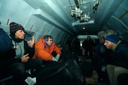Saturday, 23 February, Tiksi / Deep down the MI8's breakdown was not as serious as all that. In deed, on that Saturday, 23 February, the men woke up at dawn. It was the local authorities that came to bring them the good news: the chopper would be ready to leave at about 10am. Here, the crew inside an Antonov between Khatanga and Tiksi.