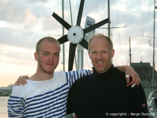 28 June /  Børge and his son Max enjoyed a few hours in Bergen, before parting ways for now. Behind them can be seen the wind generator, which provides the power needed on board.