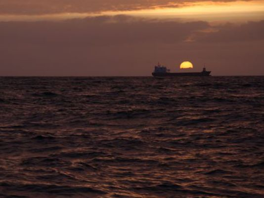 17 May 2011, first encounter with a cargo ship, at sunset. The 10 knot breeze has reappeared.