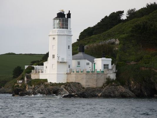 18 May 2011, 6.30 am, they have reached Start Point. St Anthony's head lighthouse painted in white signals the mouth of the Fal river.