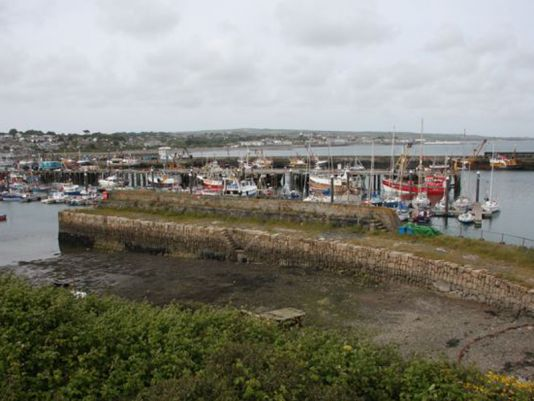 The old port of Newlyn. The main jetee was built in 1980 and inaugurated by her Majesty Queen Elisabeth II
