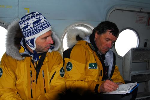 On the helicoter MI8 that will bring them to the departure point, Alain looks over his notes.