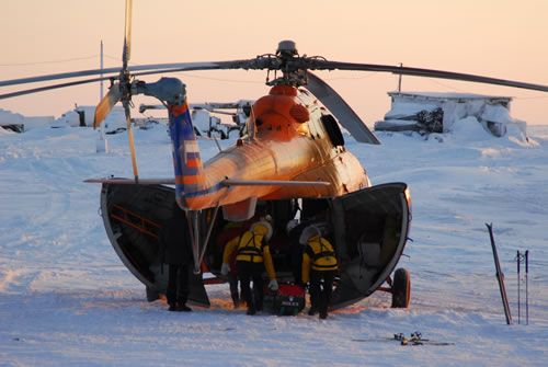 The expedition equipment is loaded onto the MI8 helicopter.