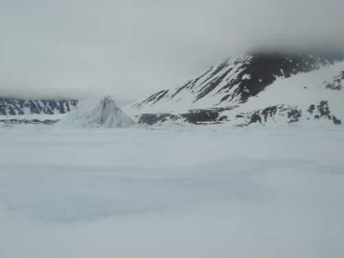 14 June: The Mountains Are Getting Nearer: The last iceberg before the coast.